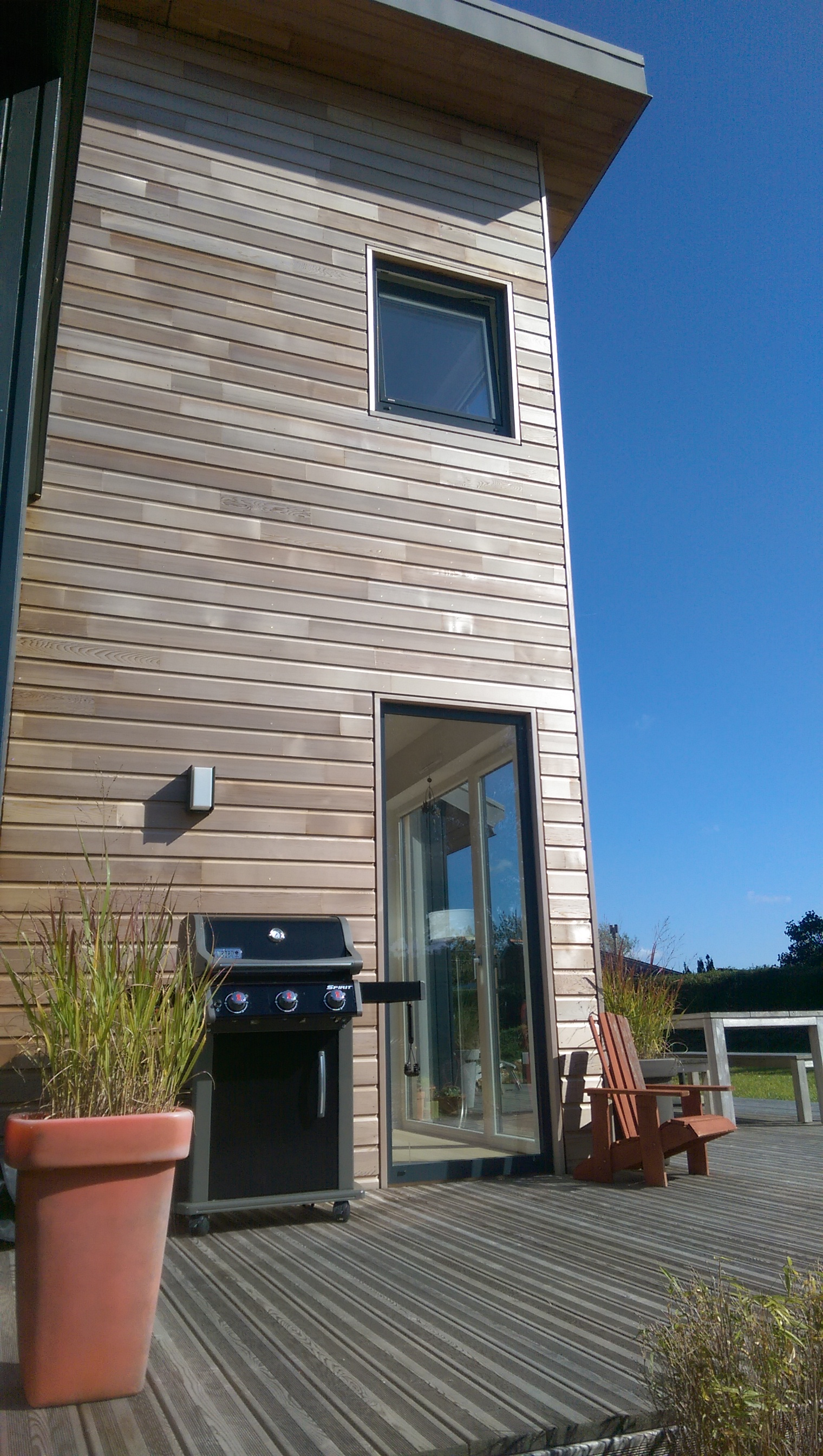 Construction de maisons en bois GLV : maison à étage avec toiture en zinc